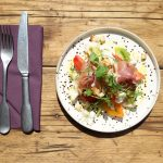Heritage tomato salad with knife and fork