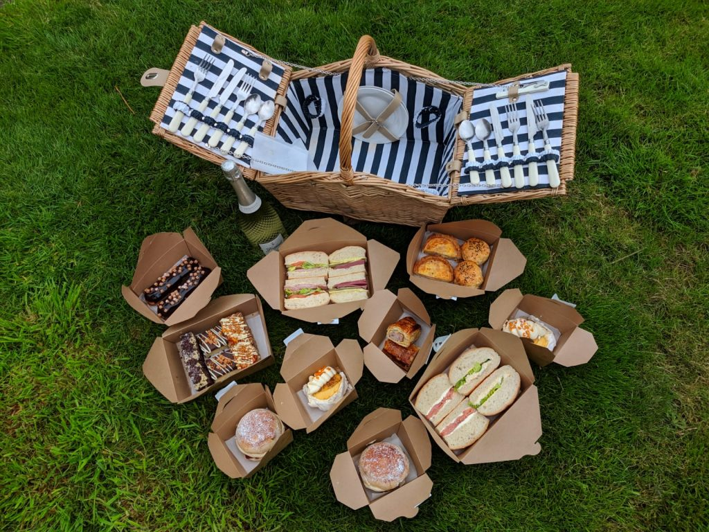 Picnic hamper with food in boxes