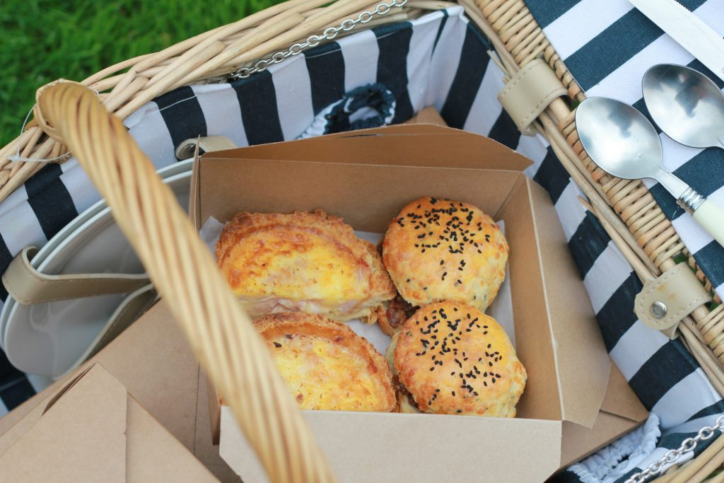 Picnic basket with quiche and scone